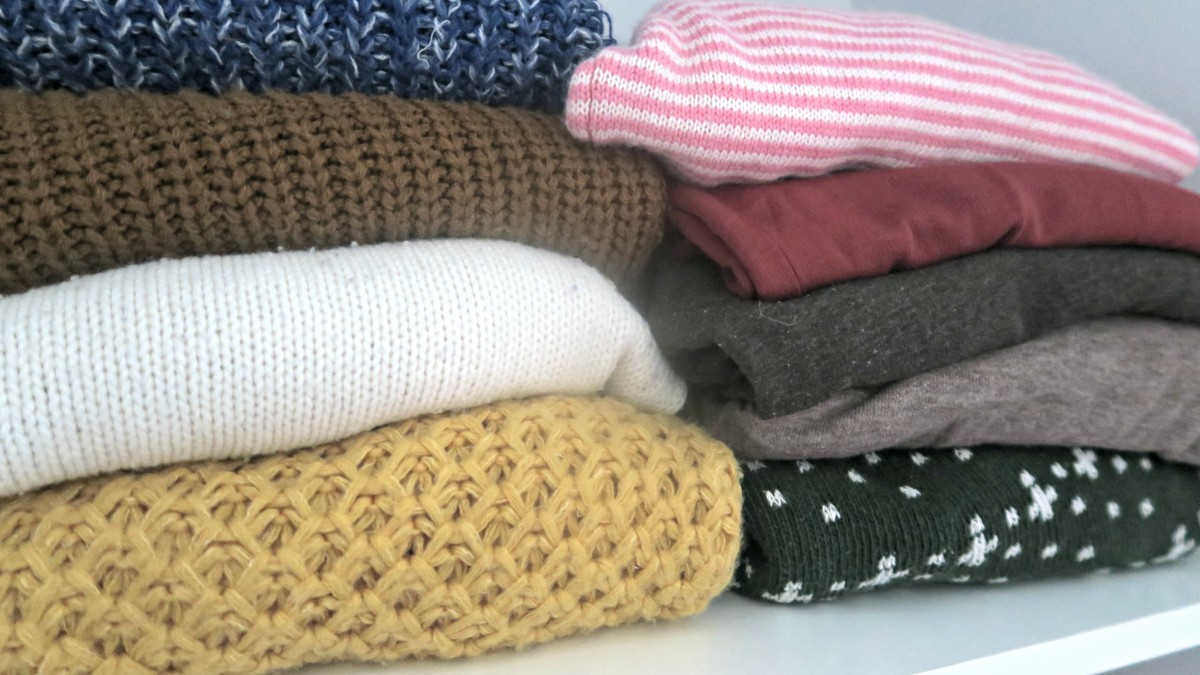 neatly stacked jumpers sweaters