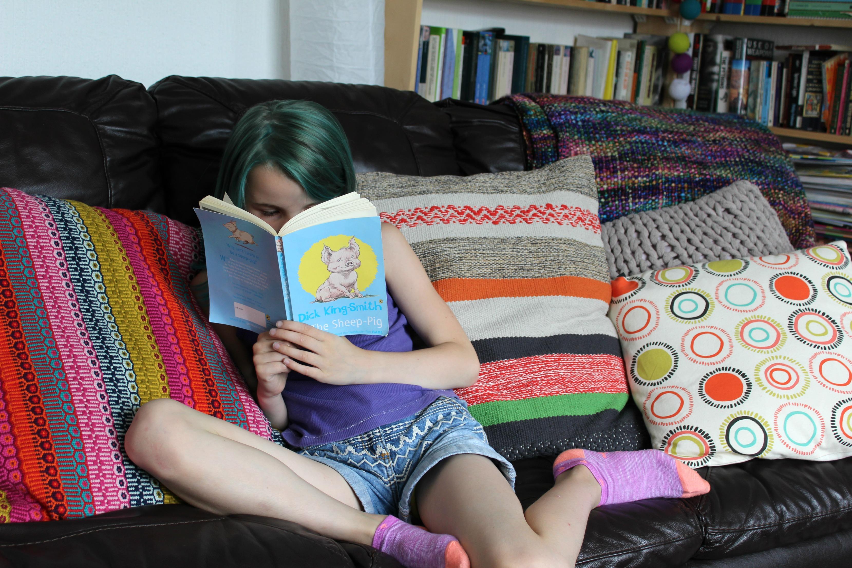 kiki reading. family sofa